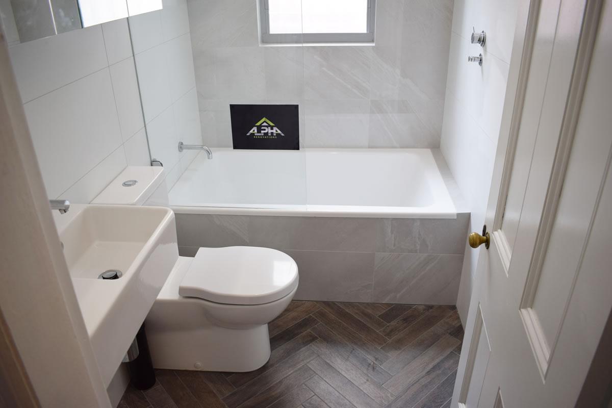 Staggered tile floor tiles